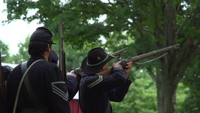 Civil War soldiers firing a volley. View of Civil War soldiers firing a volley stock video footage
