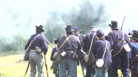 Civil War soldiers in the heat of pitched battle stock video