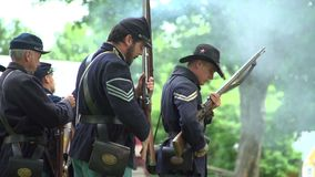 Civil War soldiers performing reloads during war stock footage