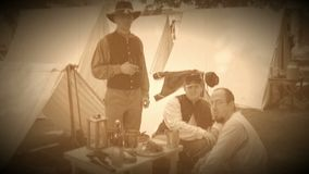 Civil War soldiers pose in an encampment (Archive Footage Version) stock video