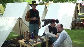 Civil War soldiers pose in an encampment stock video