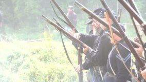 Civil War soldiers reloading and firing in battle stock video