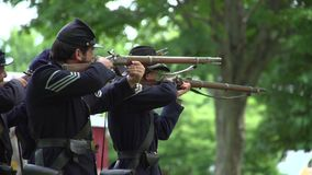 Civil War soldiers shooting into enemy lines stock video