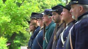 Civil War soldiers shoulder their guns. View of Civil War soldiers shoulder their guns stock video footage