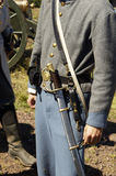 Civil War Uniform 1. Detail of a uniform during a civil war battle enactment Royalty Free Stock Images