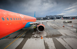 Civilian airliner with jet engine on runway at storm Royalty Free Stock Image
