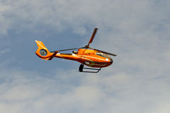 Civilian helicopter flying in the sky Royalty Free Stock Images