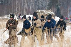 Civilians figthing cudgel. RUSSIA, APRELEVKA - FEBRUARY 7: Unidentified civilians armed with cudgel walk on reenactment of the Napoleonic maneuvers near the Royalty Free Stock Image