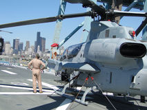 Civilians inspect an AH-1W Super Cobra Royalty Free Stock Photography