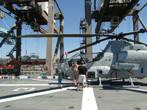 Civilians inspect an AH-1W Super Cobra helicopter. SEATTLE - AUG 4 - Civilians inspect an AH-1W Super Cobra helicopter during a tour of the Amphibious Assault Royalty Free Stock Image