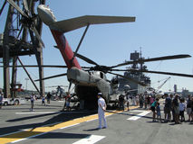 Civilians inspect an CH-53E Sea Stallion. SEATTLE - AUG 4 - Civilians inspect an CH-53E Sea Stallion helicopter,during a tour of the Amphibious Assault Ship Stock Photo