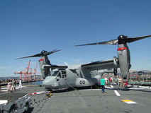 Civilians inspect an  MV-22 Osprey. SEATTLE - AUG 4 - Civilians inspect an  MV-22 Osprey,during a tour of the Amphibious Assault Ship Bonhomme Richard, LDH-6 Royalty Free Stock Photos