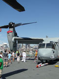 Civilians inspect an  MV-22 Osprey. SEATTLE - AUG 4 - Civilians inspect an  MV-22 Osprey,during a tour of the Amphibious Assault Ship Bonhomme Richard, LDH-6 Royalty Free Stock Image