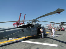 Civilians inspect an SH-60 Seahawk. SEATTLE - AUG 4 - Civilians inspect an SH-60 Seahawk [variation of the army's UH-60 Blackhawk helicopter]during a tour of the Stock Image