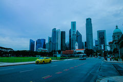 Civilization. There are many buildings backside and the cars are coming in Singapore Stock Photo