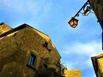 Civita di Bagnoregio, ciudad en la provincia de Viterbo, Italia Historia, tiempo, arquitectura, lámpara, iluminación, cielo, pare imagen de archivo