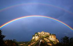 Civita di Bagnoregio Italy with rainbow. A dying little town Stock Photography