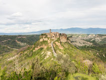 Civita di Bagnoregio The town that is dying. Civita di Bagnoregio in Italy is an example of a medieval city relatively untouched by modern life. Known as ' stock photo