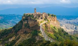 The famous Civita di Bagnoregio hit by the sun on a stormy day. Province of Viterbo, Lazio, Italy. royalty free stock photo