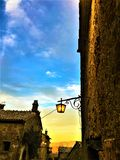 Civita di Bagnoregio, town in the province of Viterbo, Italy. Sunset, history, architecture, lamp, lighting, sky, wall and beauty. Civita di Bagnoregio, a town stock photo