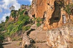 Civita di Bagnoregio, Viterbo, Lazio, Italia: la parete rocciosa di Th Fotografia Stock