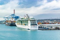 Royal Caribbean Cruise Line Jewel of The Seas Cruise Ship and MSC Maureen Cargo Ship docked in the Port of Civitavecchia, Rome. royalty free stock photography