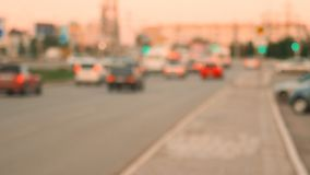 Ciy road in sunset time. Defocused cars moving along perspective view. stock footage