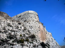 СKrak des Chevaliers. The wall and tower Stock Photos