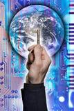 Clé au monde de la technologie Image libre de droits
