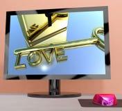 Clé d'amour sur l'écran d'ordinateur montrant la datation en ligne Image stock