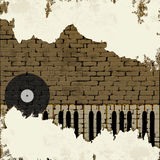Clé de piano de fond de musique dans un mur de briques Image libre de droits