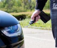 Clé de porte-clés de voiture à disposition Photo stock