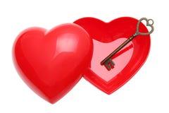 Clé de vintage et coeur rouge Image stock
