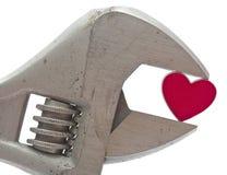 Clé et coeur en croissant Images stock