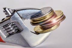 Clé et pièces de monnaie Photo stock