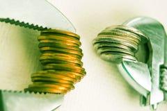 Clé et pièces de monnaie Images stock
