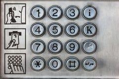 Clés d'une cabine téléphonique photo stock