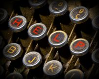Clés de machine à écrire d'aide Images stock
