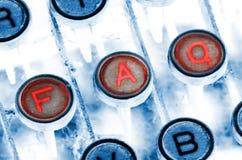 Clés de machine à écrire de FAQ Photographie stock