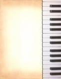 Clés de piano sur le vieux papier Images libres de droits