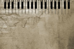 Clés et notes texturisées de piano Photos stock