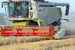 Claas combine harvester closeup. Stock Photo