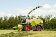 Claas Harvester cutting field Royalty Free Stock Images