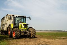Green claas tractor and cattle sheep trailer Stock Photography
