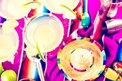 Lime margarita. Claasic lime margarita with garnish lime and turbinado sugar for Fiesta Stock Photography