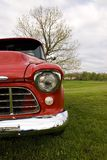 Claasic truck in field. Classic red truck in an open field Royalty Free Stock Photos