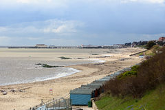 Clacton Pier viewed from the North East with beach huts Royalty Free Stock Photos