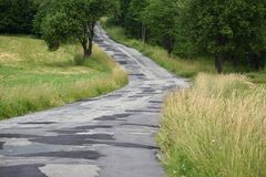 Clad asphalt road in the countryside. Road Royalty Free Stock Image