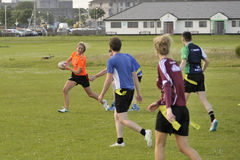 Claddagh, Galway, Ireland june 2017, friends playing touch rugby. In the free public south park fields, a girl is running with the ball while a player from the Stock Images