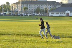Claddagh, Galway, Ireland june 2017, Mother, daughter and the do. G happy running  in the free public south park fields Stock Images
